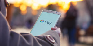 person using google pay on mobile phone
