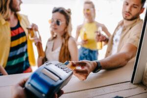 paying by card at beach bar